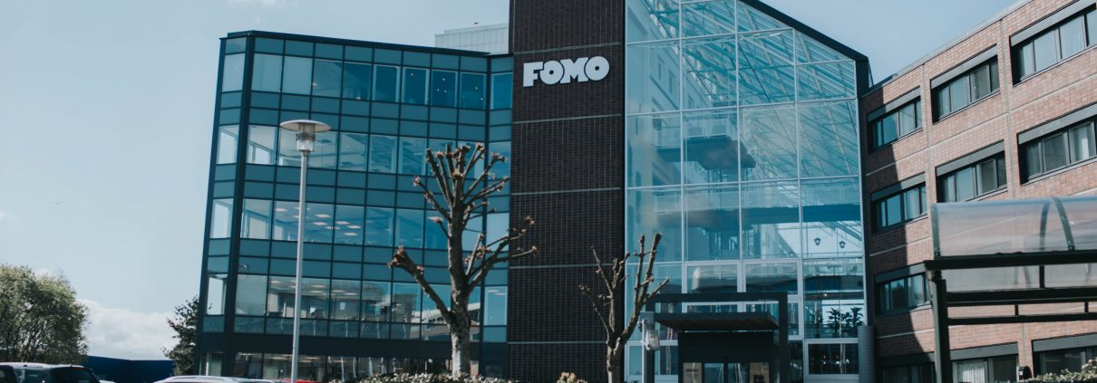 Fomo Works' building is covered with red bricks and glass walls. It is situated right next to Ikea and highway E39.